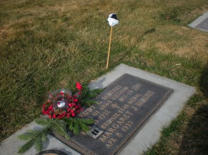 We placed items at his marker to honor his memory.